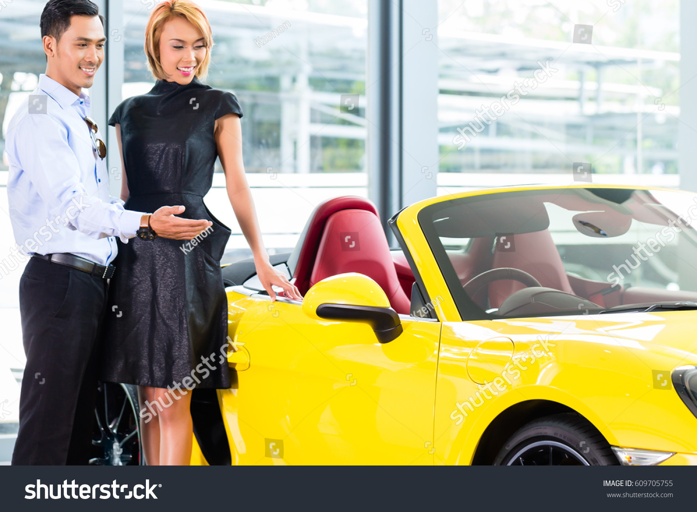 Asian Couple Choosing Luxury Sports Car Stock Photo Edit Now 609705755