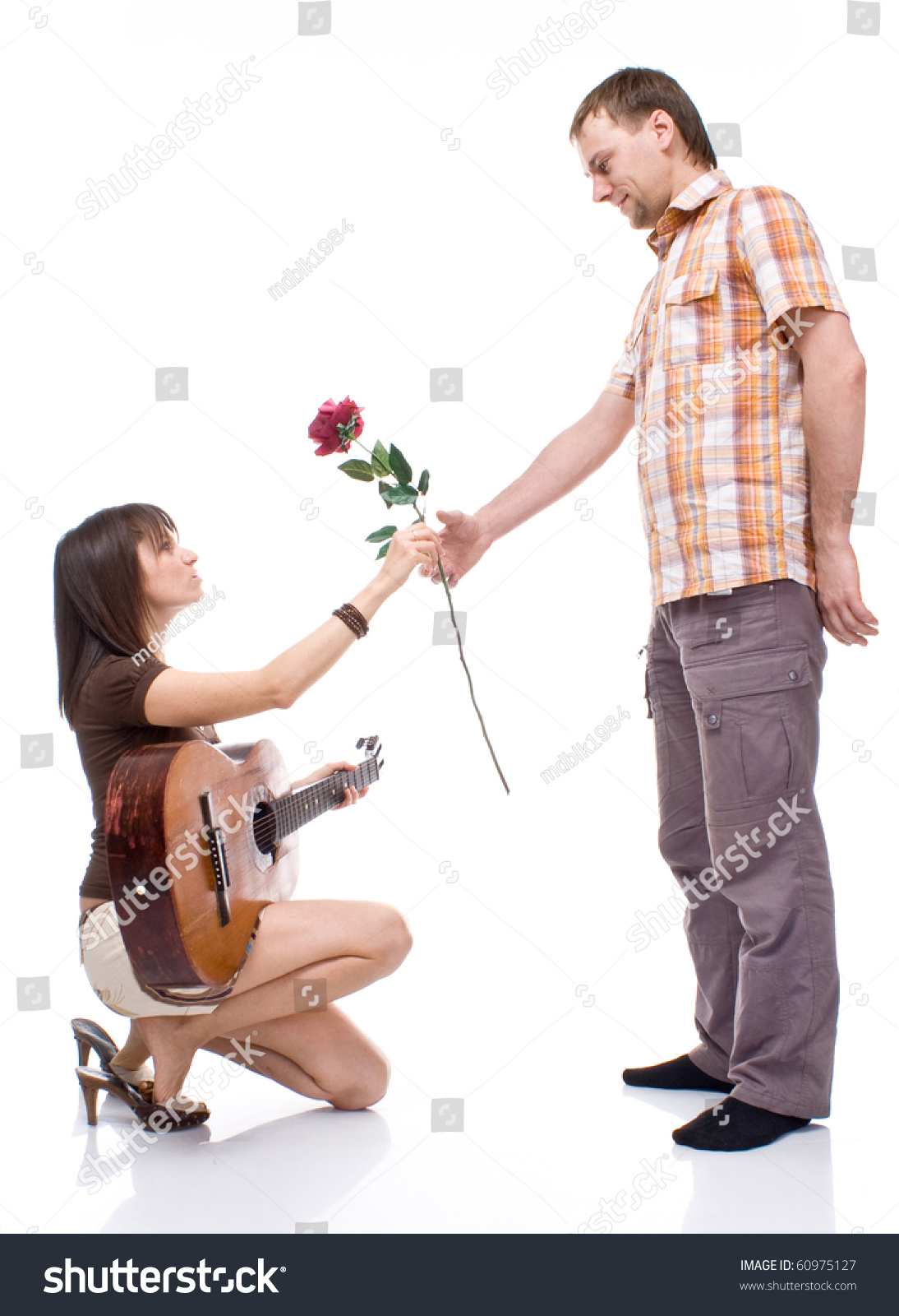 Girl Gives The Boy A Rose On White Background
