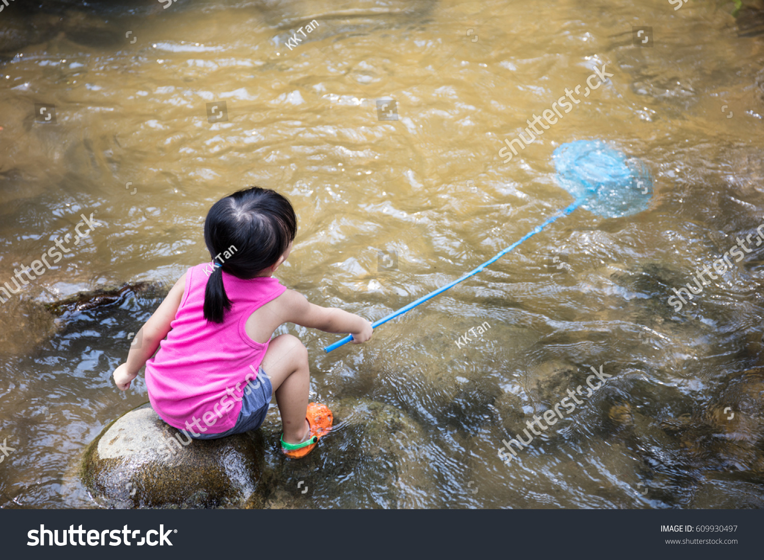 Asian chinese little girl catching fish stock photo for Fish catching net