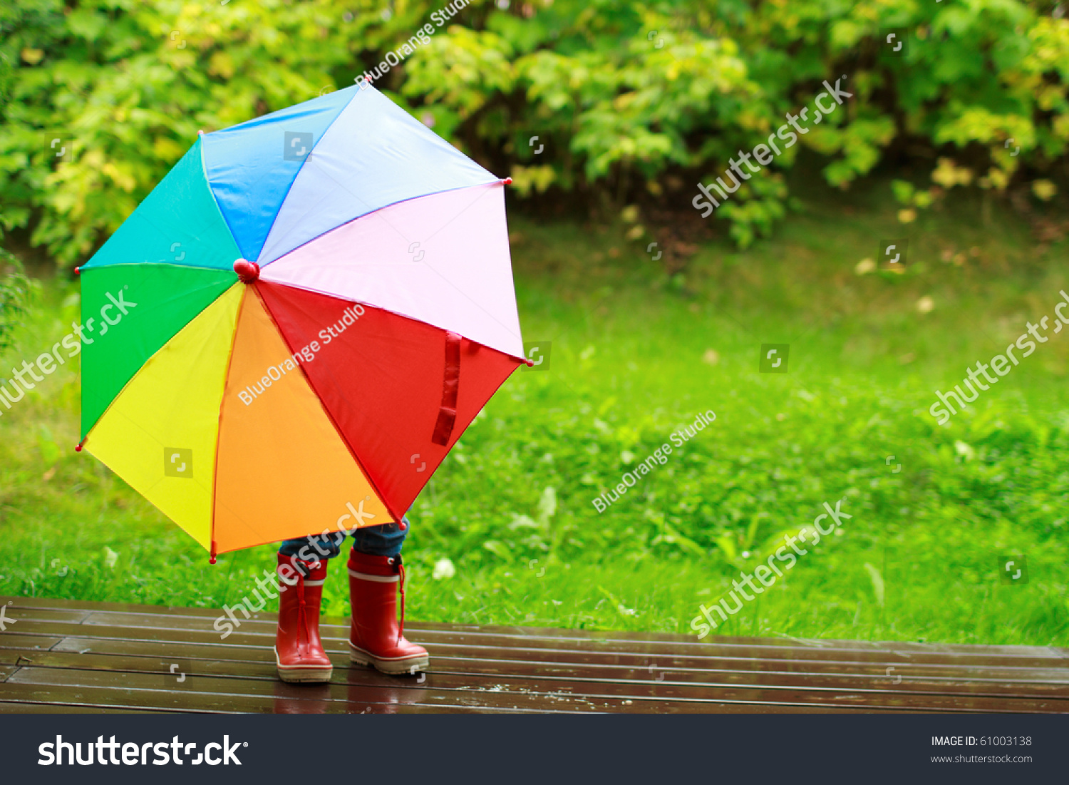 Playful Little Girl Hiding Behind Colorful Stock Photo (Edit Now ...