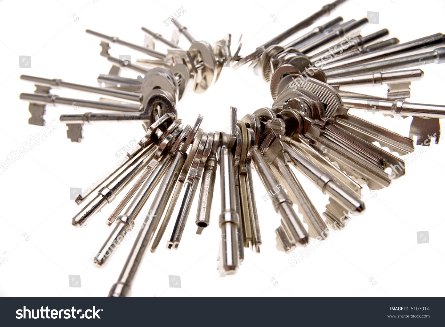 https://image.shutterstock.com/z/stock-photo-keys-on-keyring-over-white-6107914.jpg