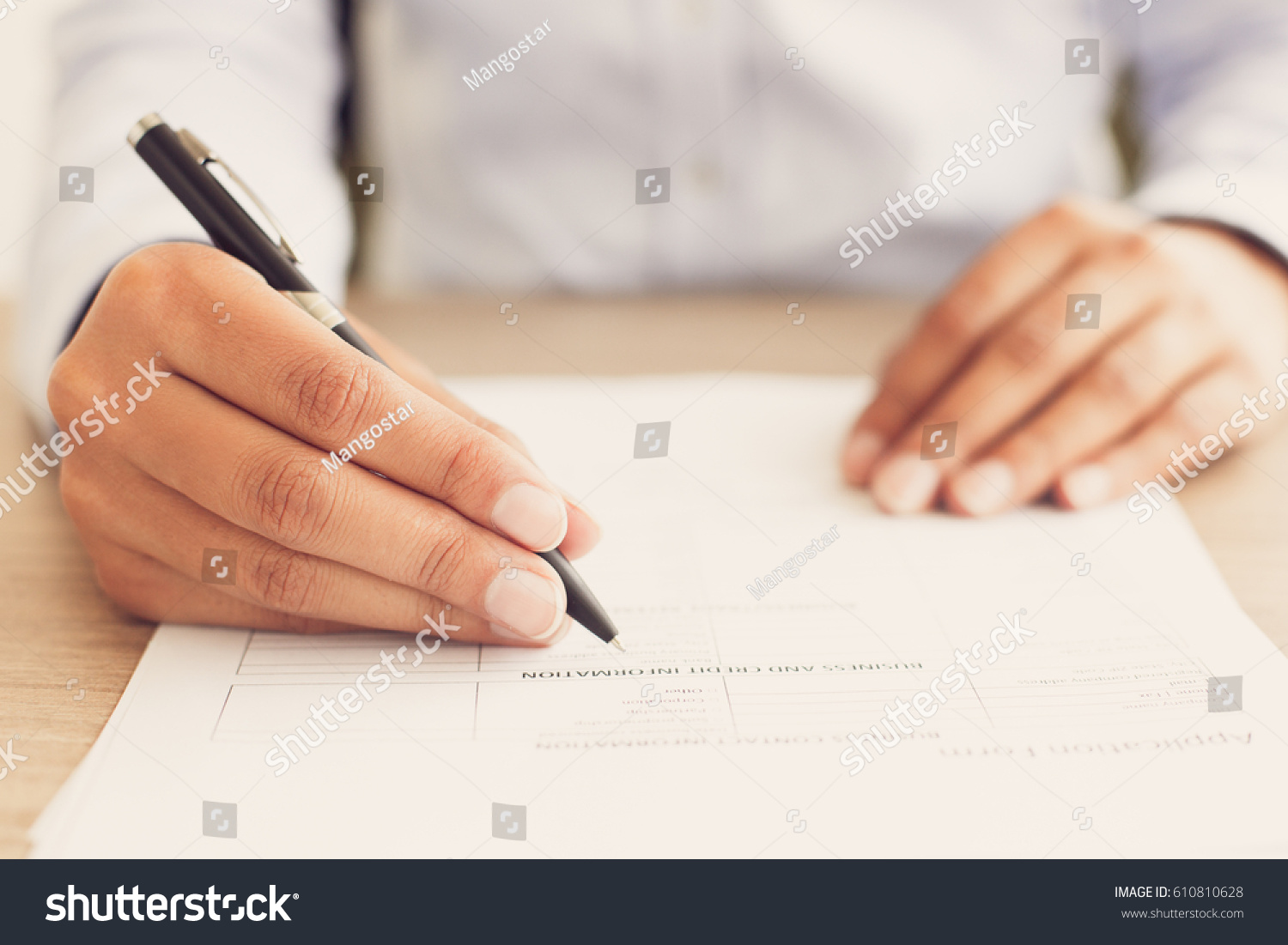 Closeup Person Completing Application Form Stock Photo 610810628 ...