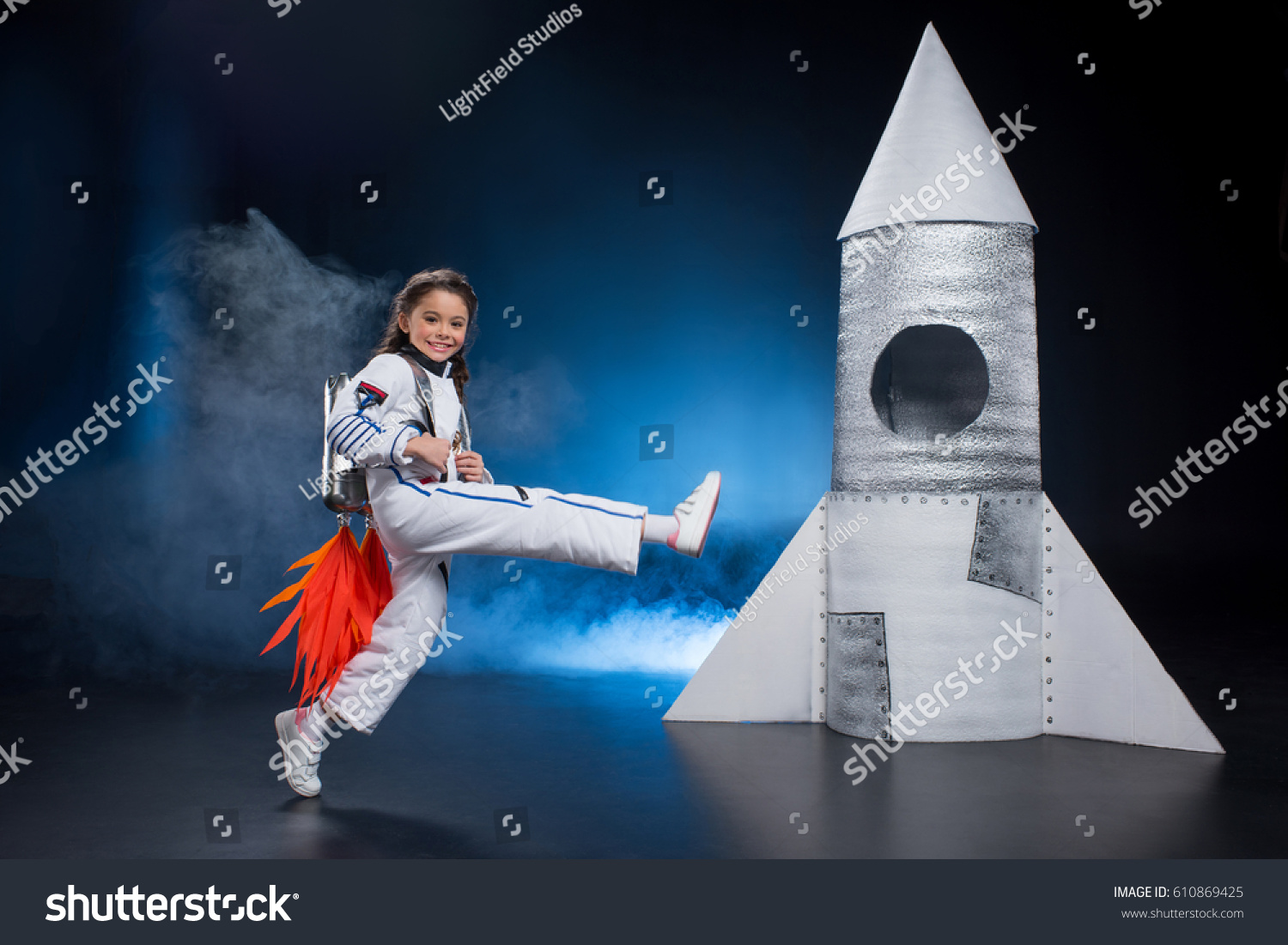 Happy Little Girl Astronaut Costume Jumping Stock Photo ...
