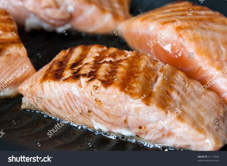 Cooking Salmon Steak On Grill Pan Stock ...