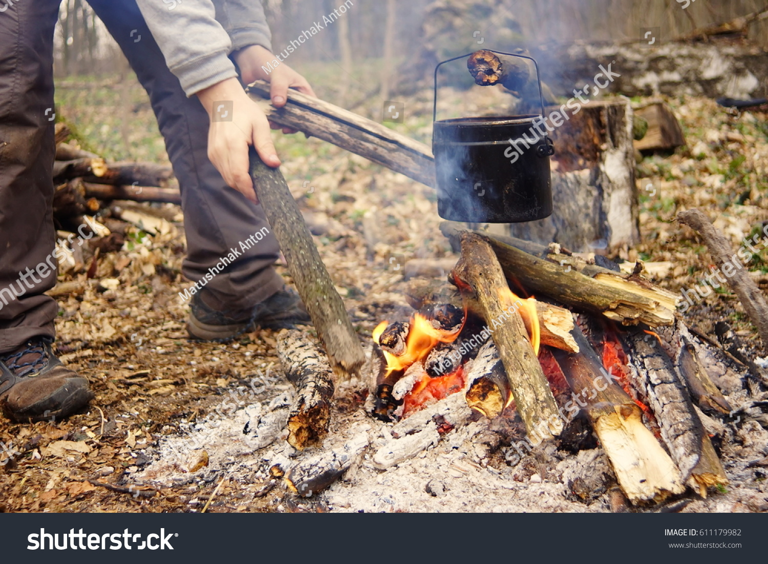 Tourist kettle on c& fire with tent on background. hand with stick about fire. & Tourist Kettle On Camp Fire Tent Stock Photo 611179982 - Shutterstock