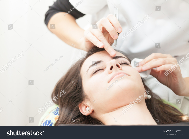 Eyebrow Picking Cosmetics Beautiful Young Girl Receiving Stock Photo