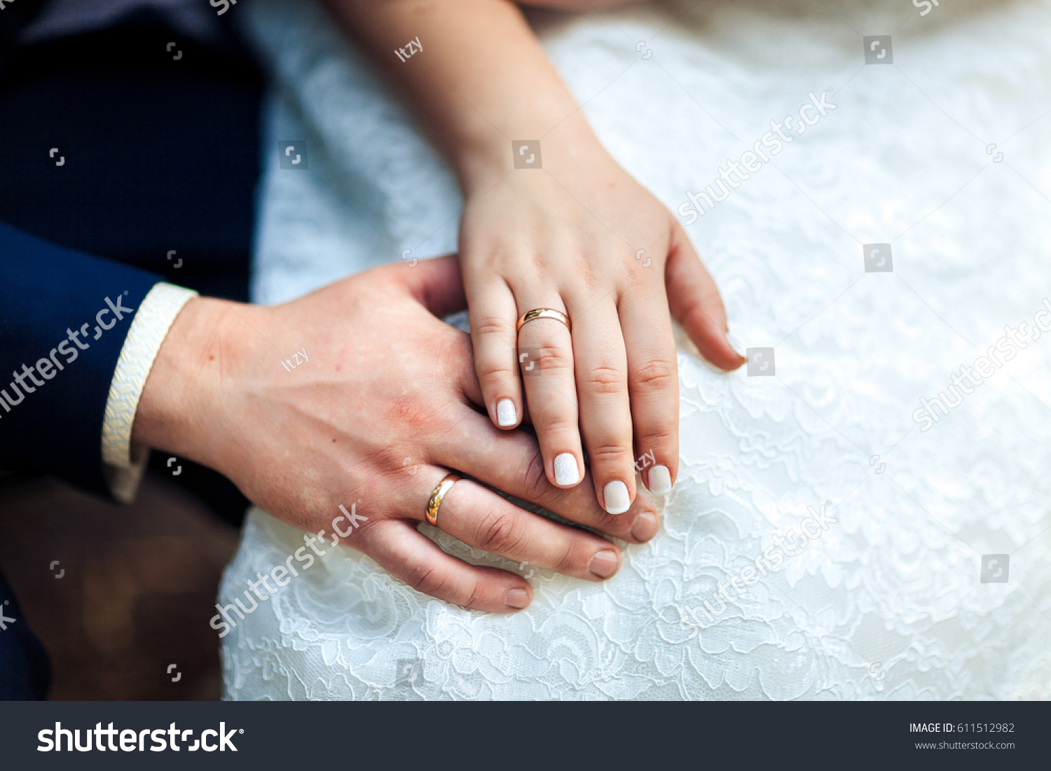 Newly wed couples hands wedding rings stock photo 611512982 newly wed couples hands with wedding rings kristyandbryce Image collections