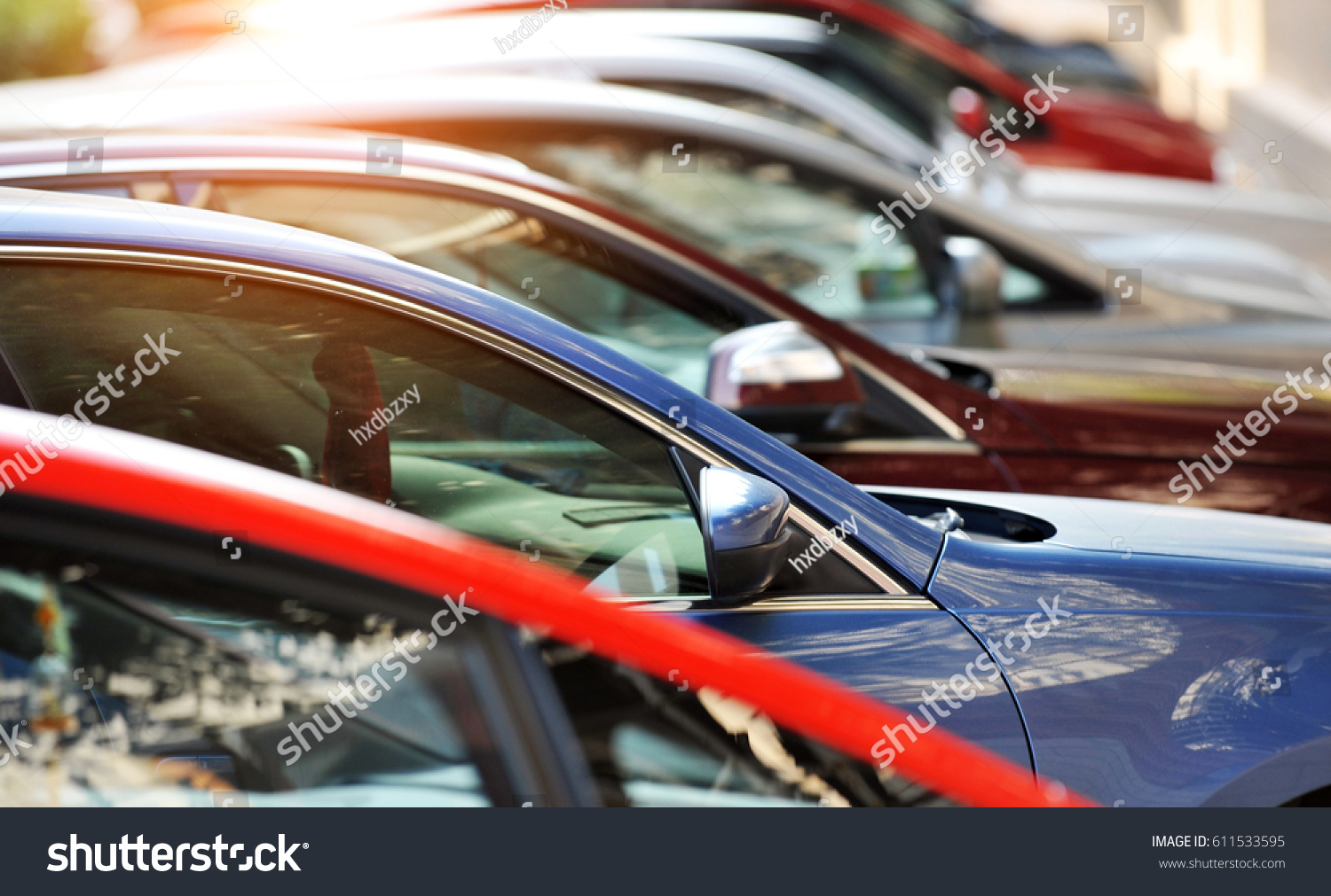 Group of cars parked in a row  #611533595