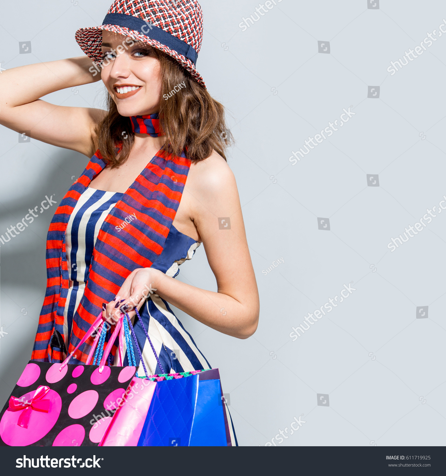 Woman posing with shopping bags isolated on white background full - Young Happy Summer Shopping Woman With Shopping Bags Isolated On Grey Background