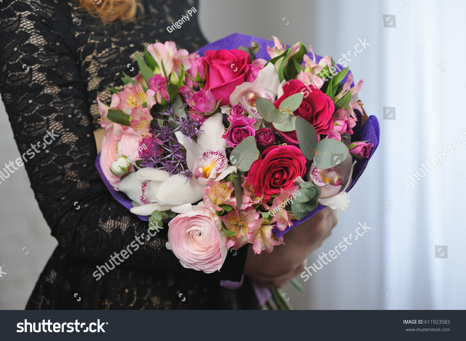 Bouquet flowers girls hands ready give stock photo edit now a bouquet of flowers in the girls hands ready to give it izmirmasajfo
