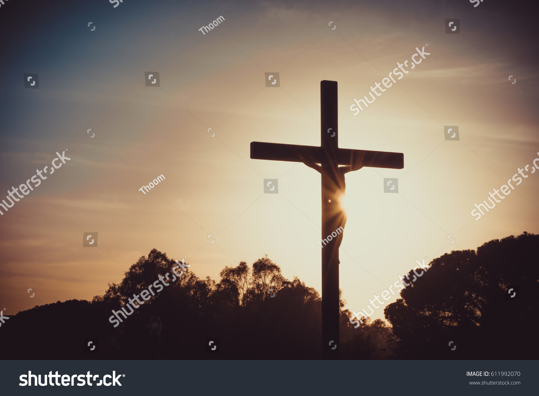 jesus christ on cross silhouette sunset stock photo 611992070