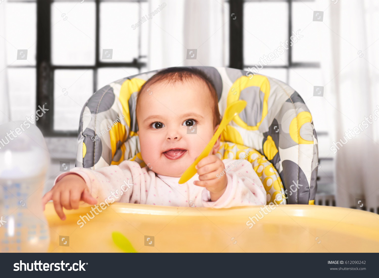 Funny baby child sitting chair spoon stock photo 612090242 for Toddler sitting chair