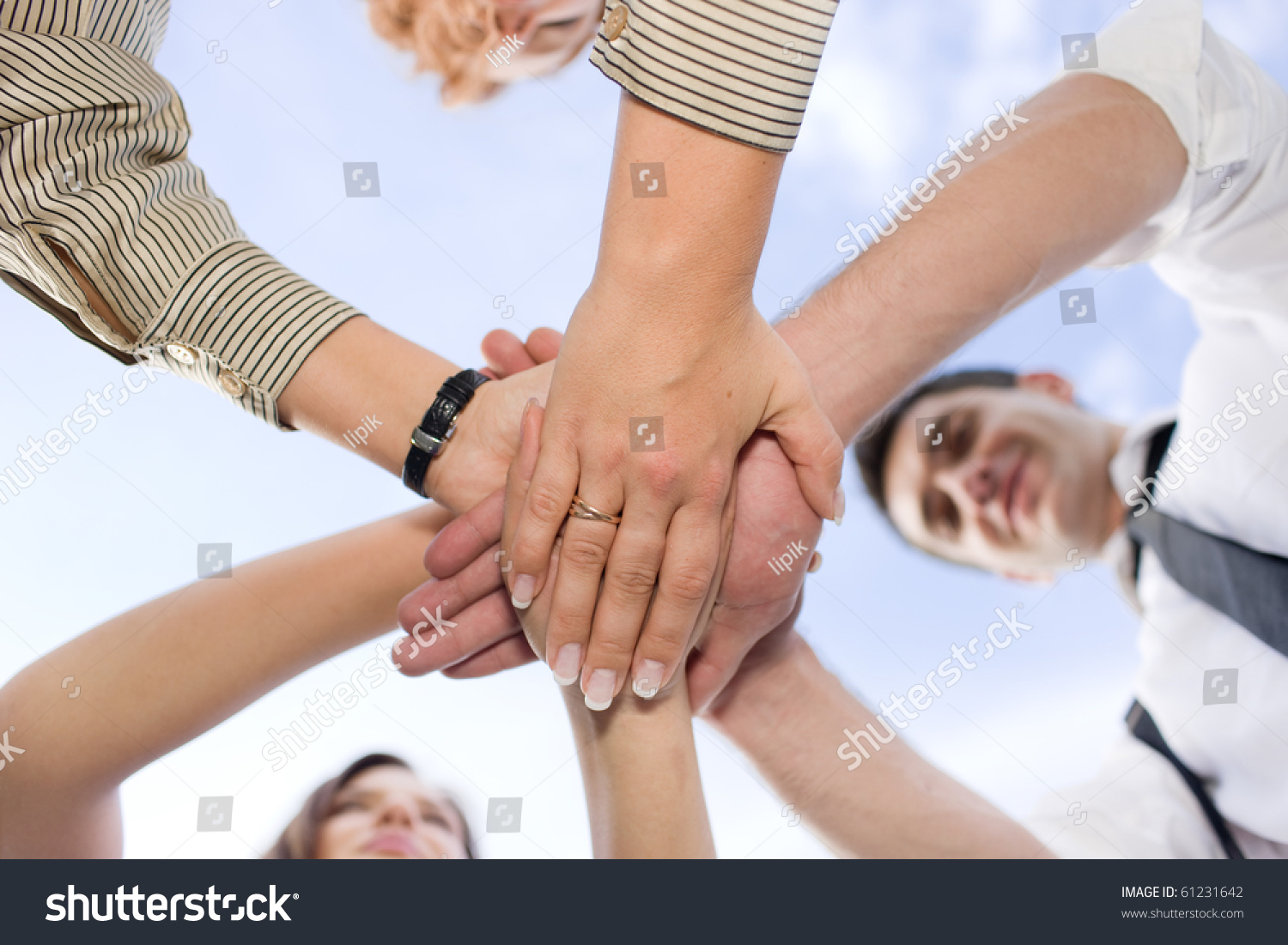 Technology Management Image: Business People Holding Hands All Together Stock Photo