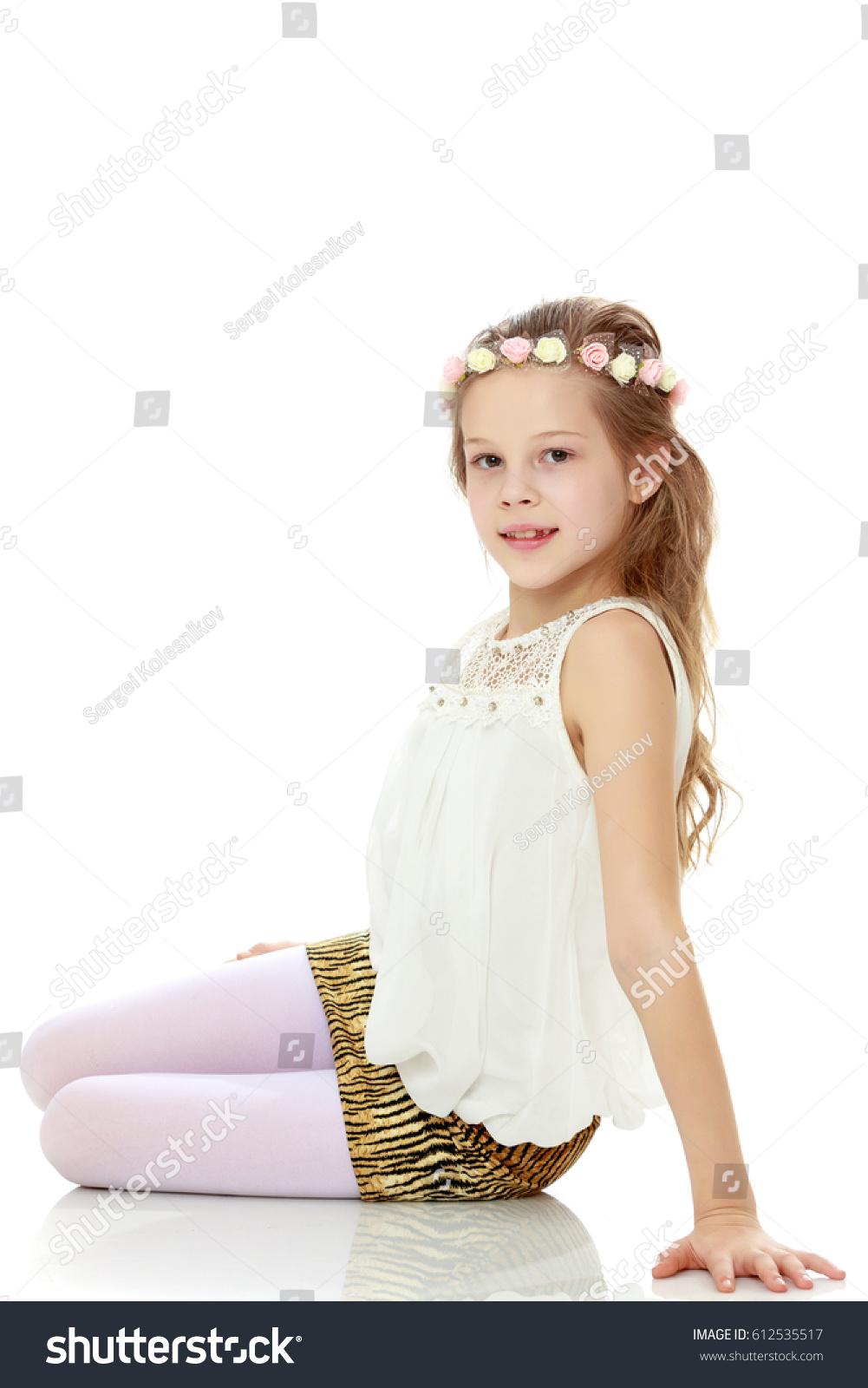 royaltyfree beautiful little girl in mini skirt