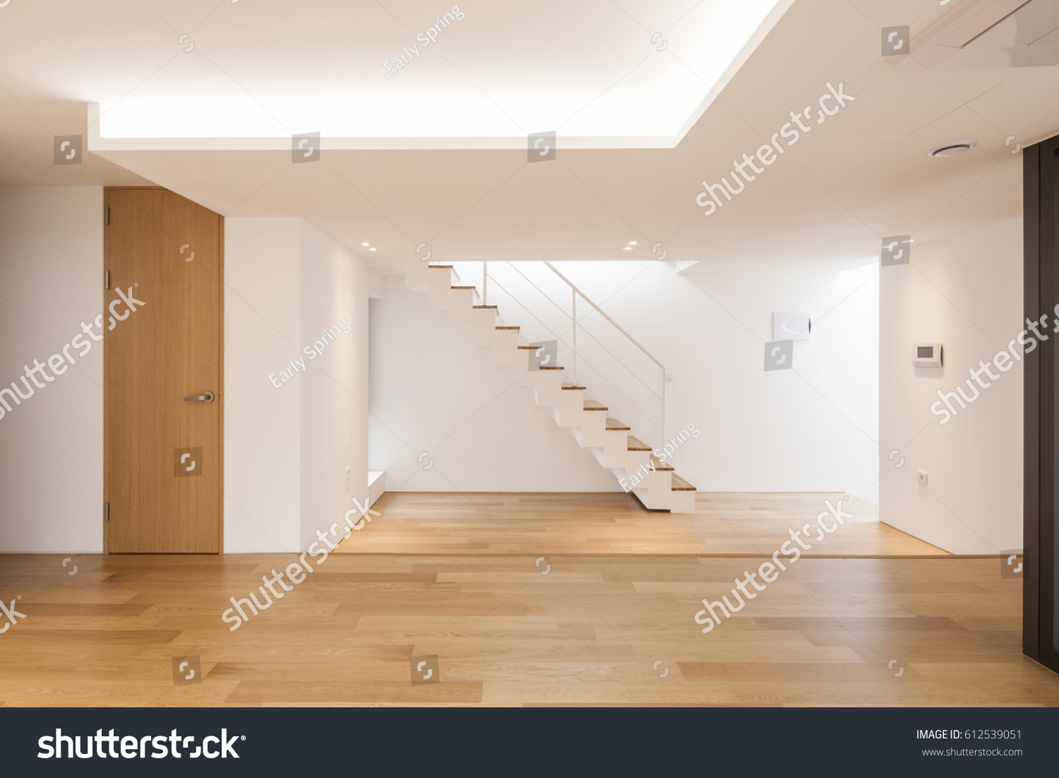 Big Empty Living Room - Empty living room with big window wood floor stair at the daylight