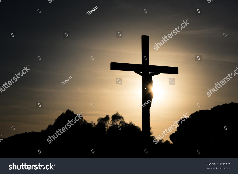 jesus christ on cross silhouette sunset stock photo 612746387