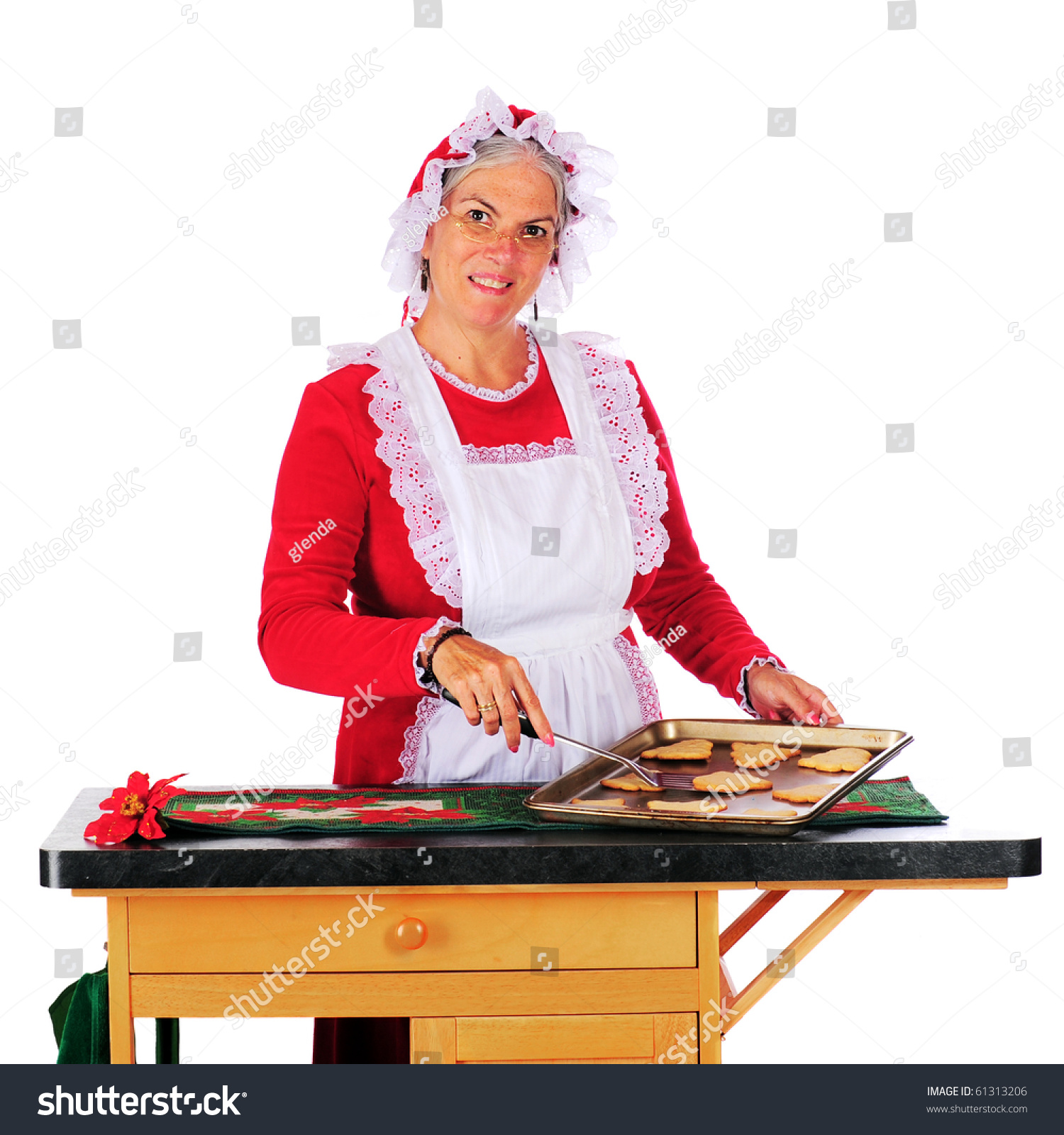 mrs claus baking christmas cookies isolated stock photo edit now