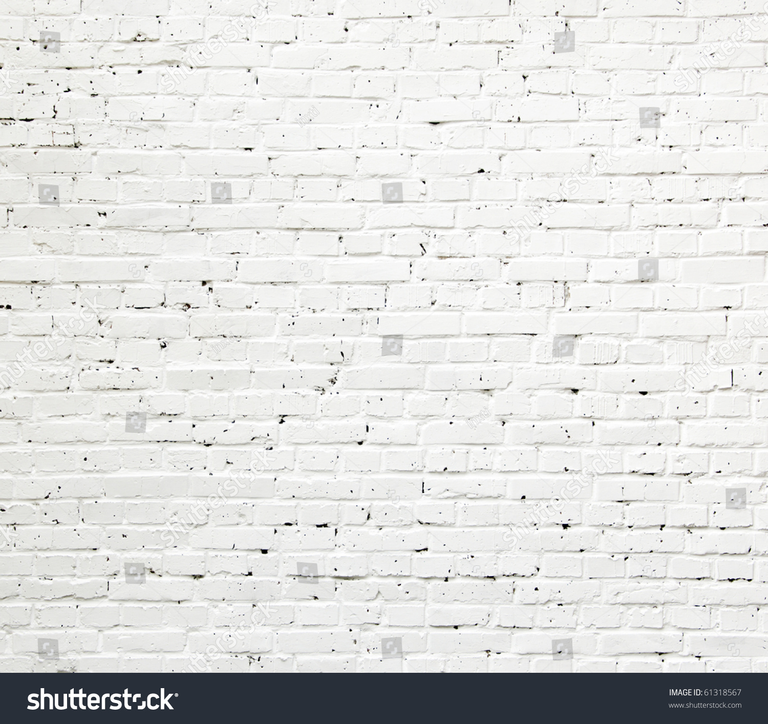 A White Roughly Textured Brick Wall Painted With White