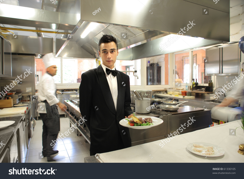 Restaurant Kitchen Background waiter showing plate cook on background stock photo 61330105