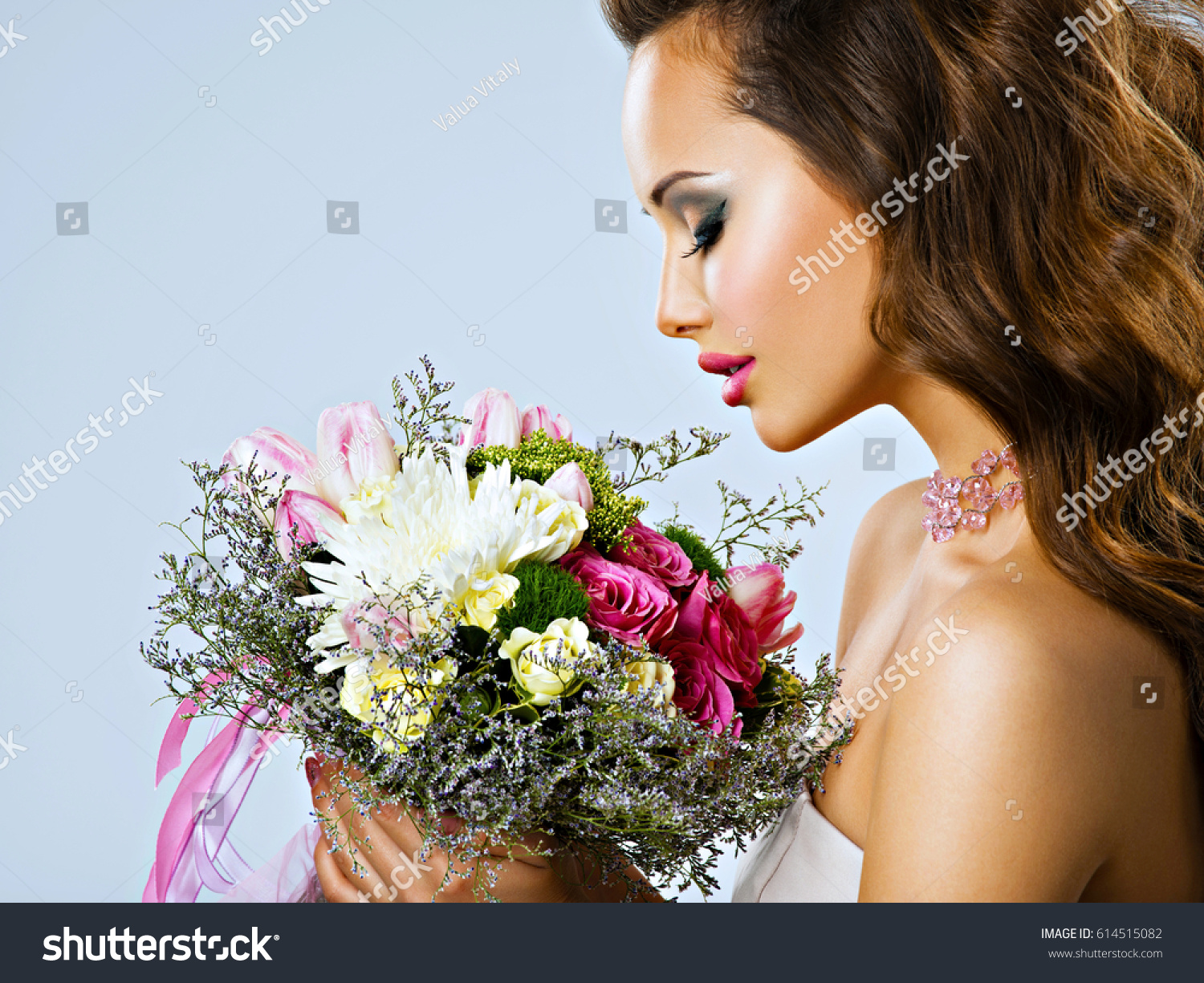 Portrait beautiful girl flowers hands happy stock photo edit now portrait of beautiful girl with flowers in hands happy young woman holds the bouquet of izmirmasajfo