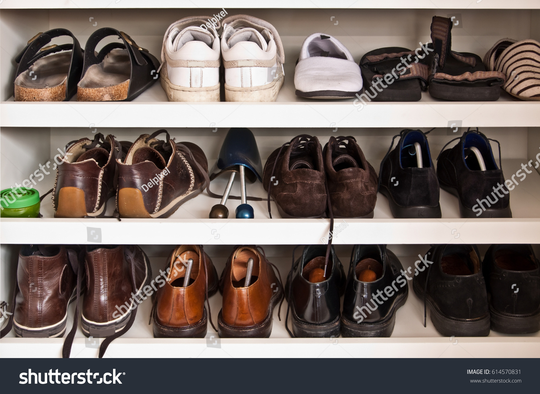 Men Shoes On Shelves In A Closet
