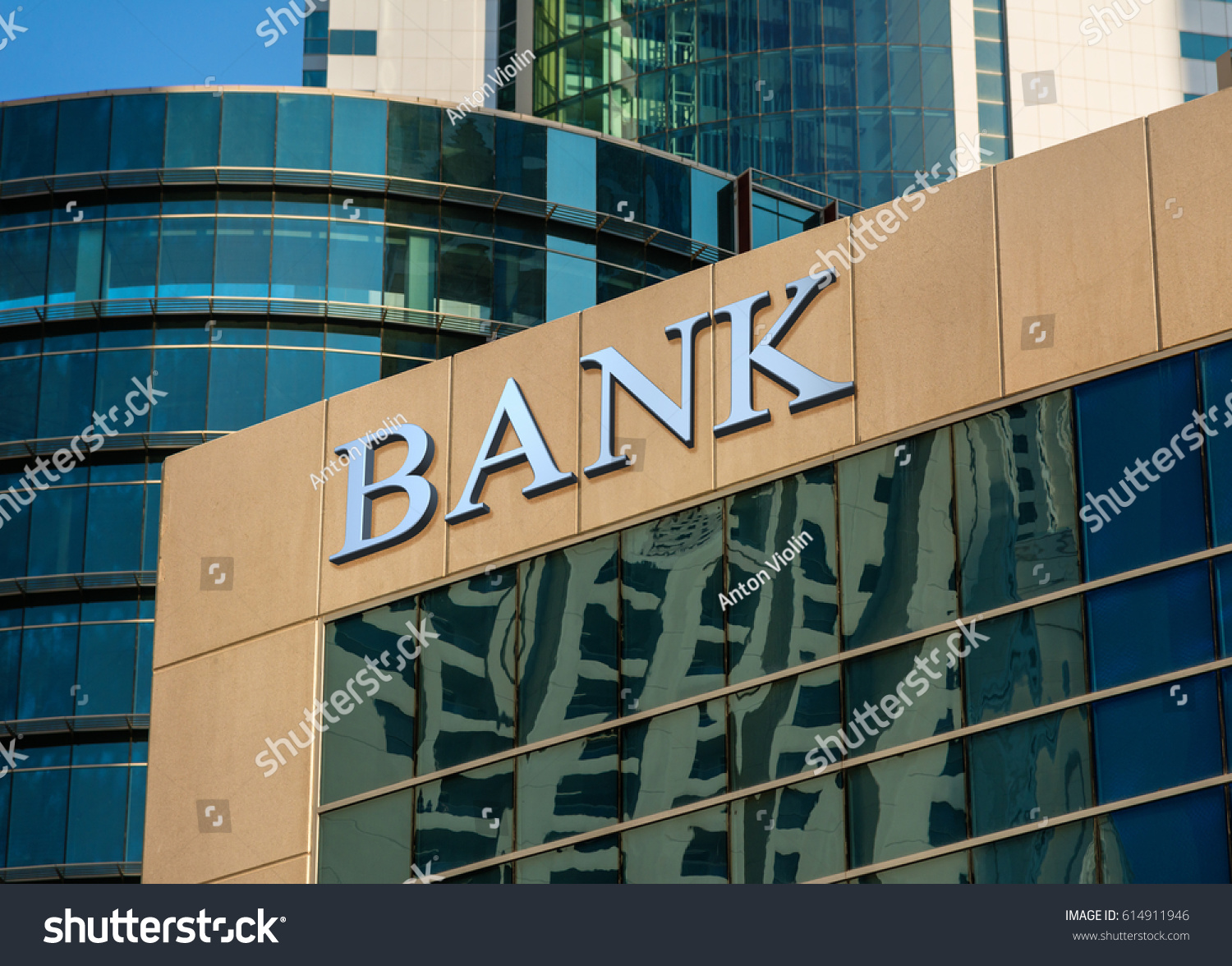 bank sign on glass wall of business center