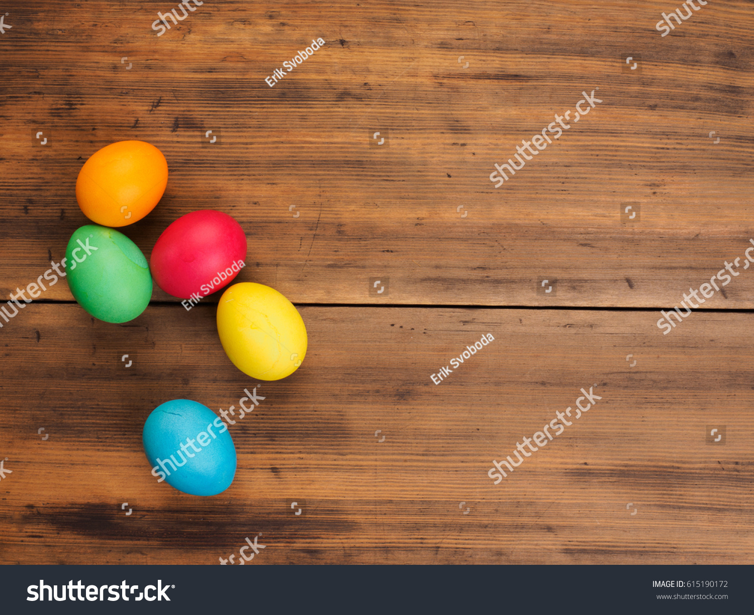 Easter Eggs On Old Brown Wood And Burlap Background Top View