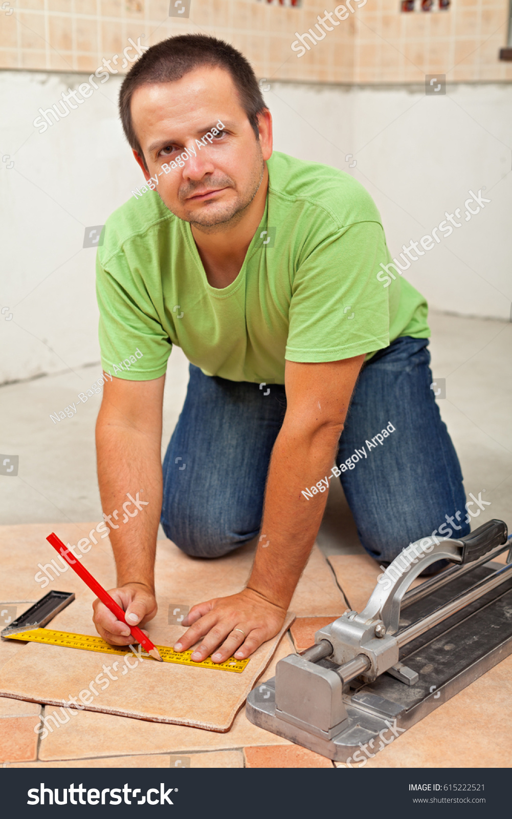 Man Laying Ceramic Floor Tiles New Stock Photo Edit Now 615222521