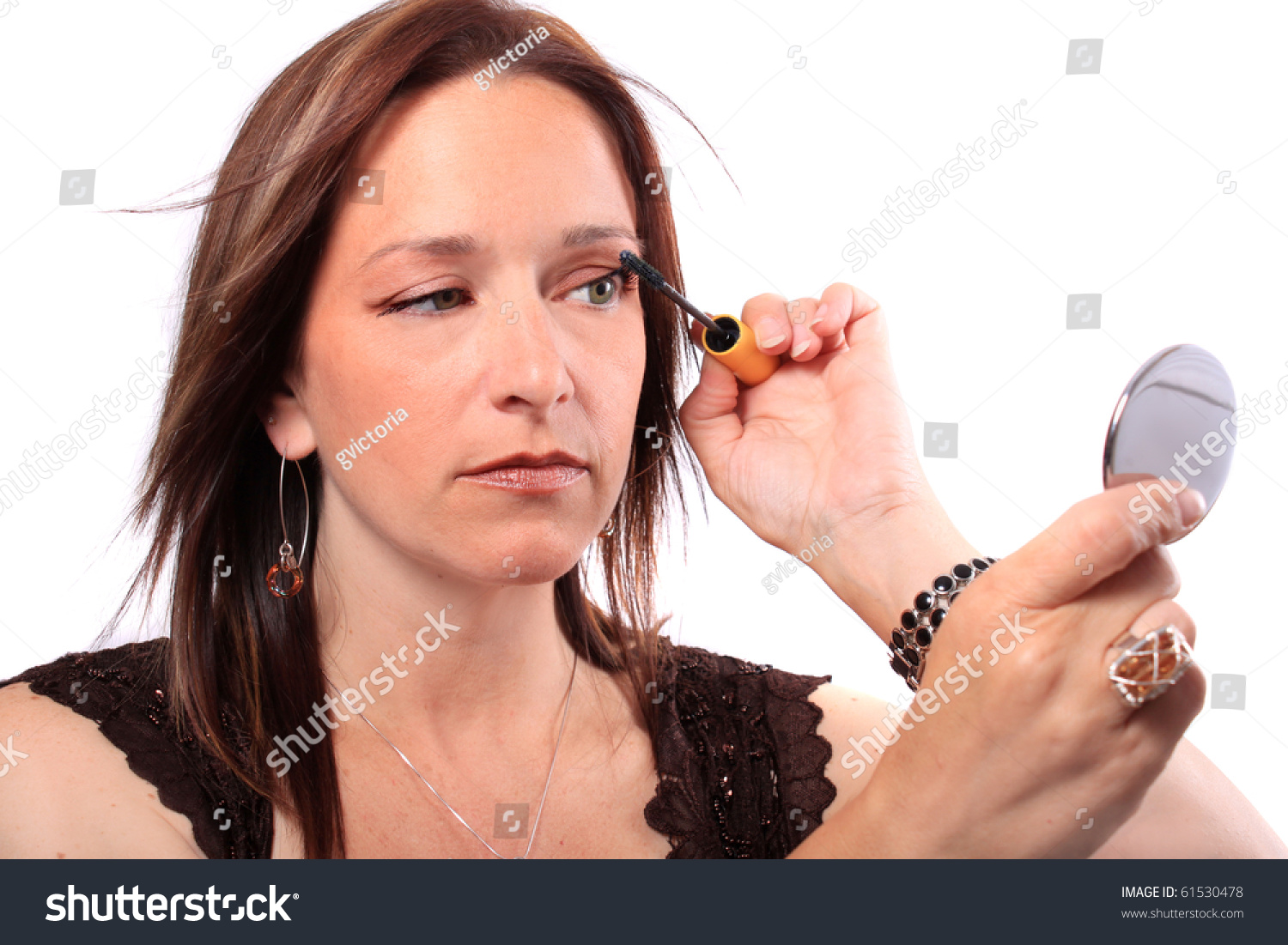 woman holding hand mirror. Woman Holding Hand Mirror Applies Mascara Stock Photo 61530478 - Shutterstock