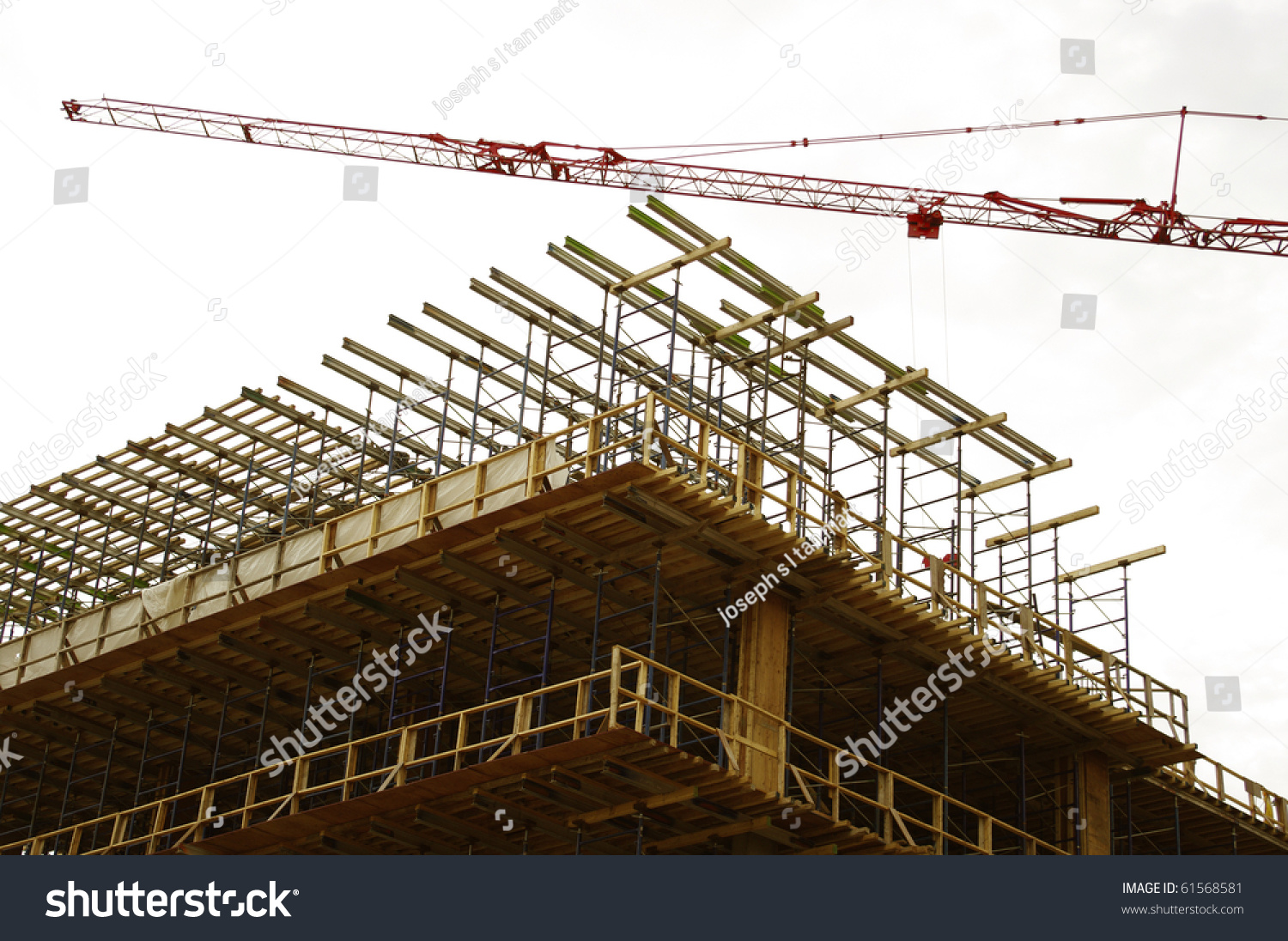 Highrise building construction top level derrick stock for Build best construction