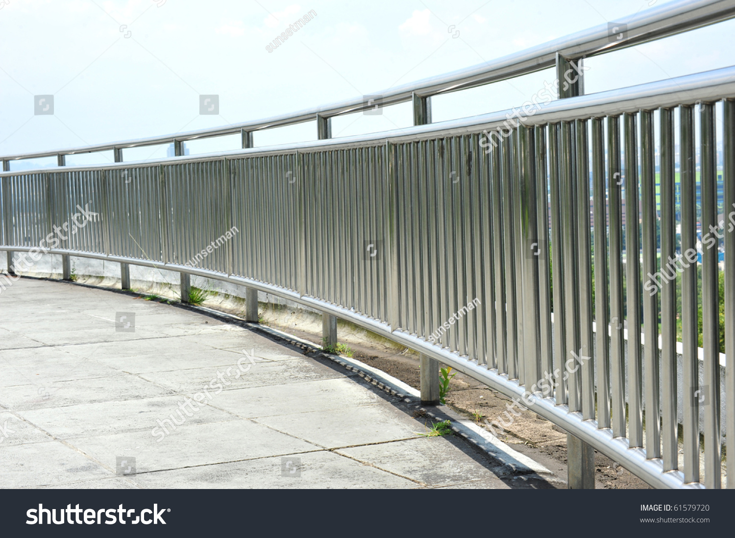 Chrome metal guard rail park stock photo