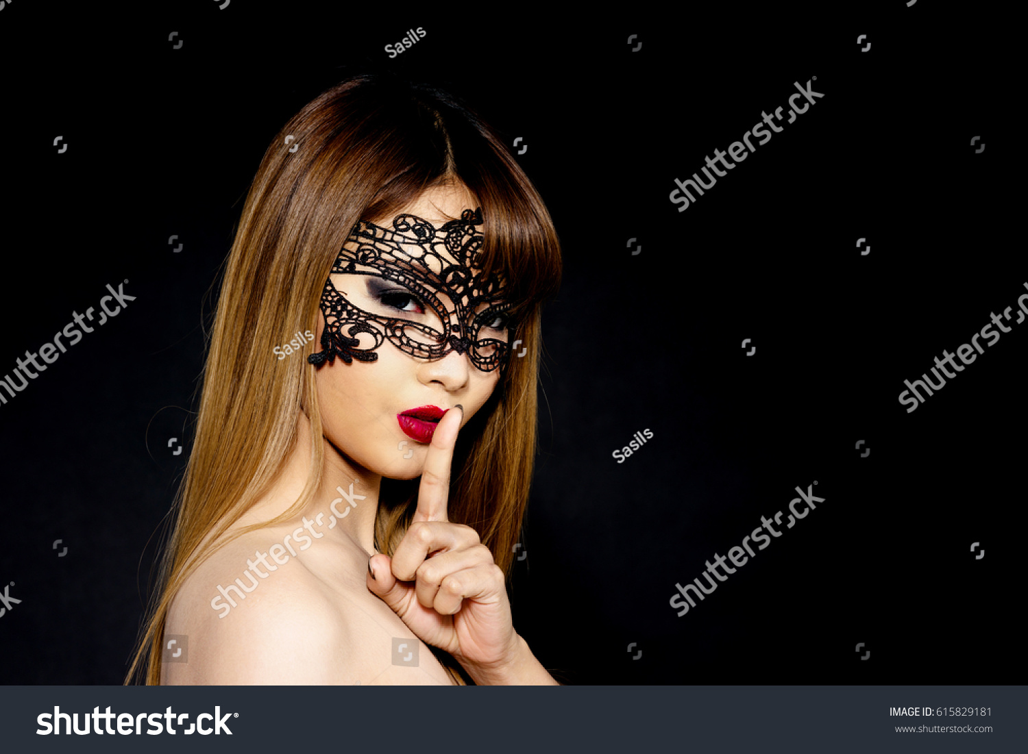 Half naked attractive Asian woman with makeup, long brown hair, black eyes,  lace erotic mask.