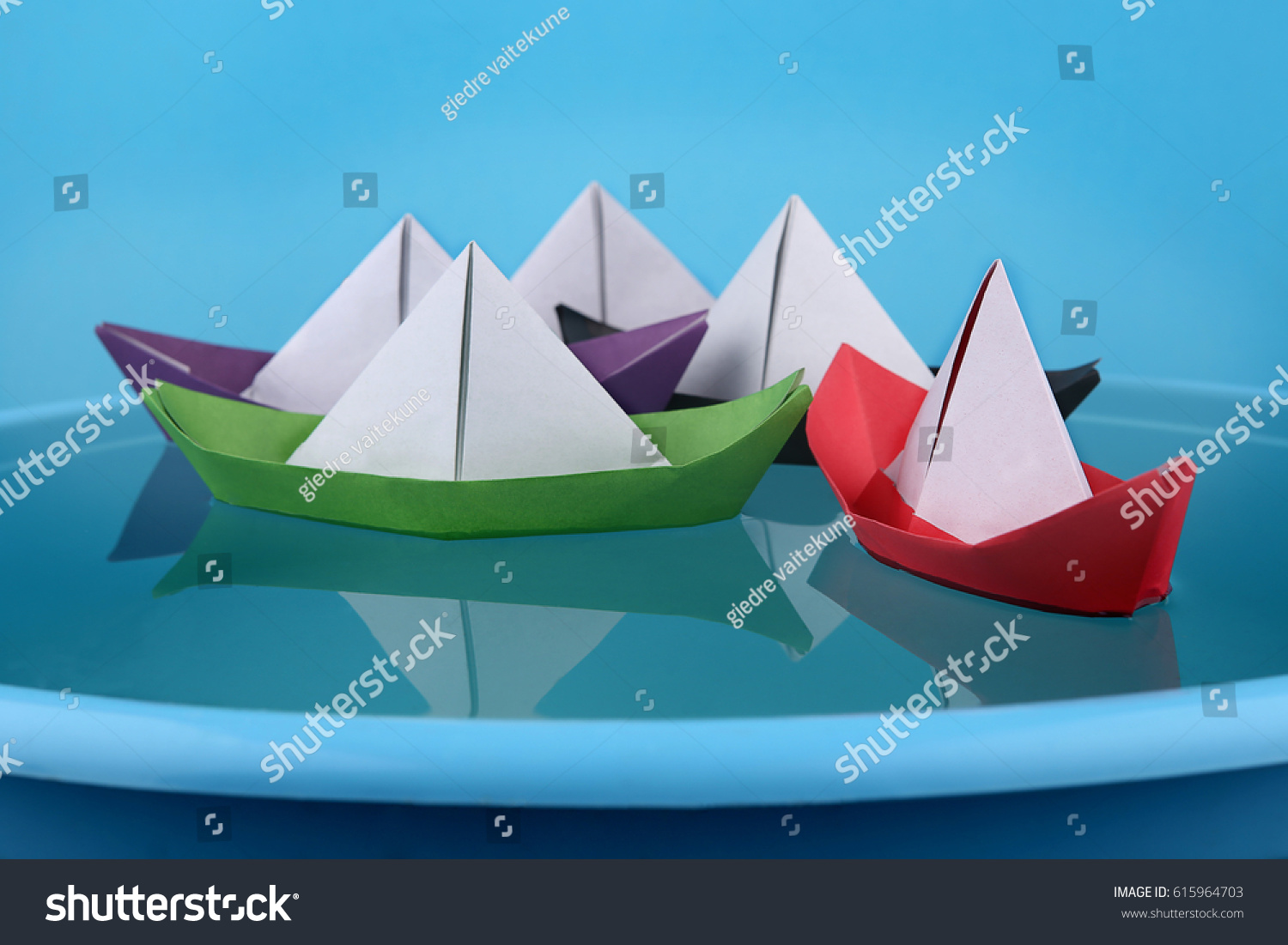 Paper boats game origami paper ships stock photo 615964703 paper boats game origami paper ships sailing on blue water surface jeuxipadfo Images