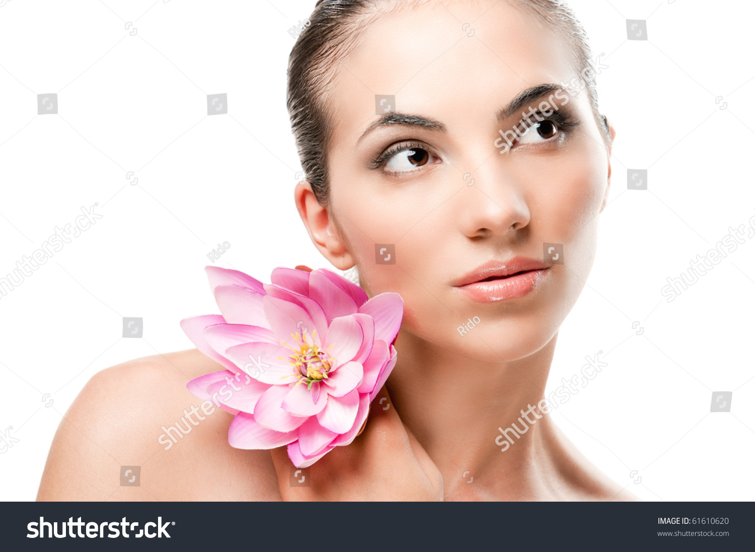 Beautiful young lady lotus flower looking stock photo royalty free beautiful young lady with lotus flower looking up isolated on white background professional beauty makeup izmirmasajfo