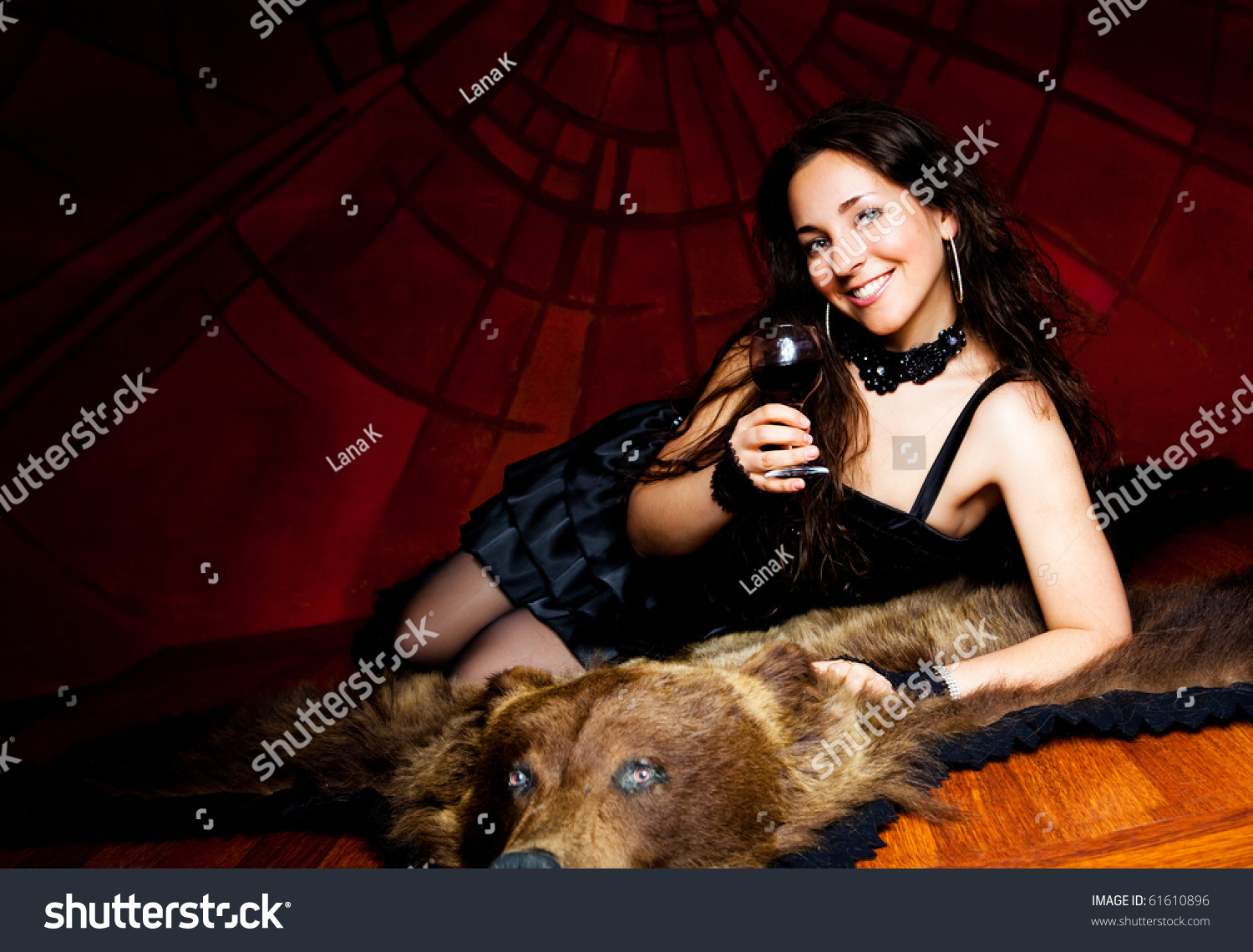 A naked woman on bear skin rug