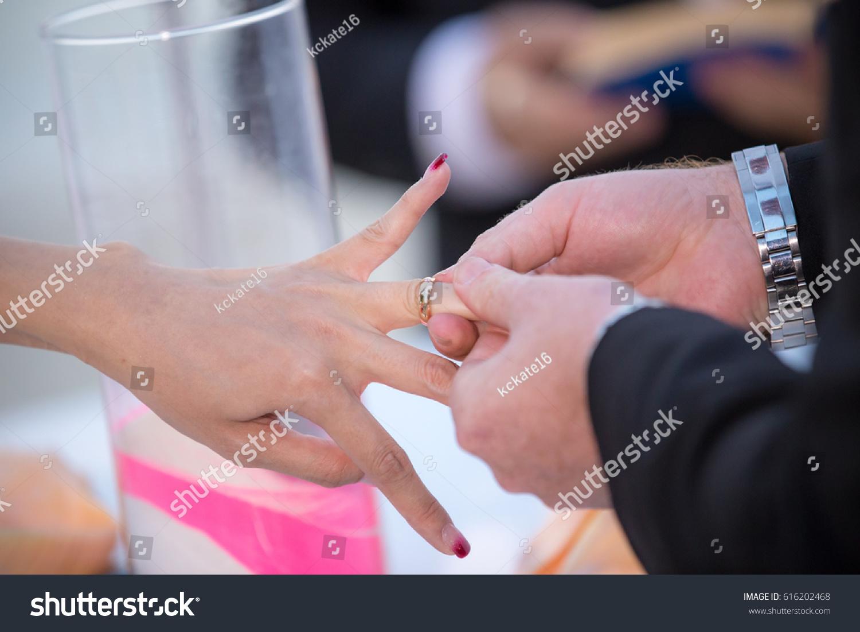 Close On Hand Groom Put On Stock Photo (Royalty Free) 616202468 ...