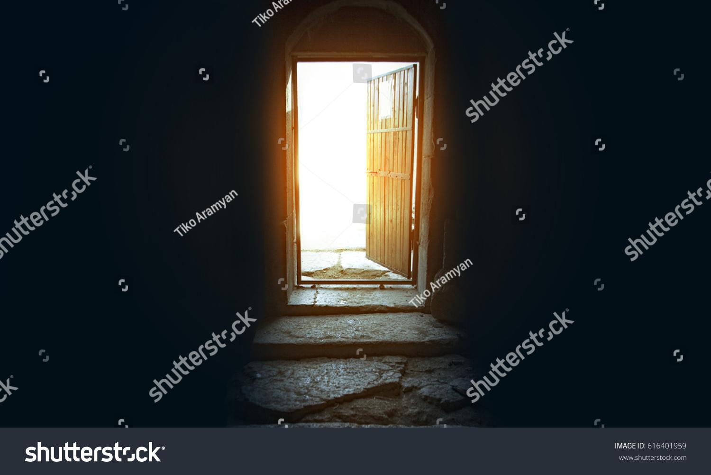 Dark room with light through window - Light Entering Through Open Door To A Dark Empty Room
