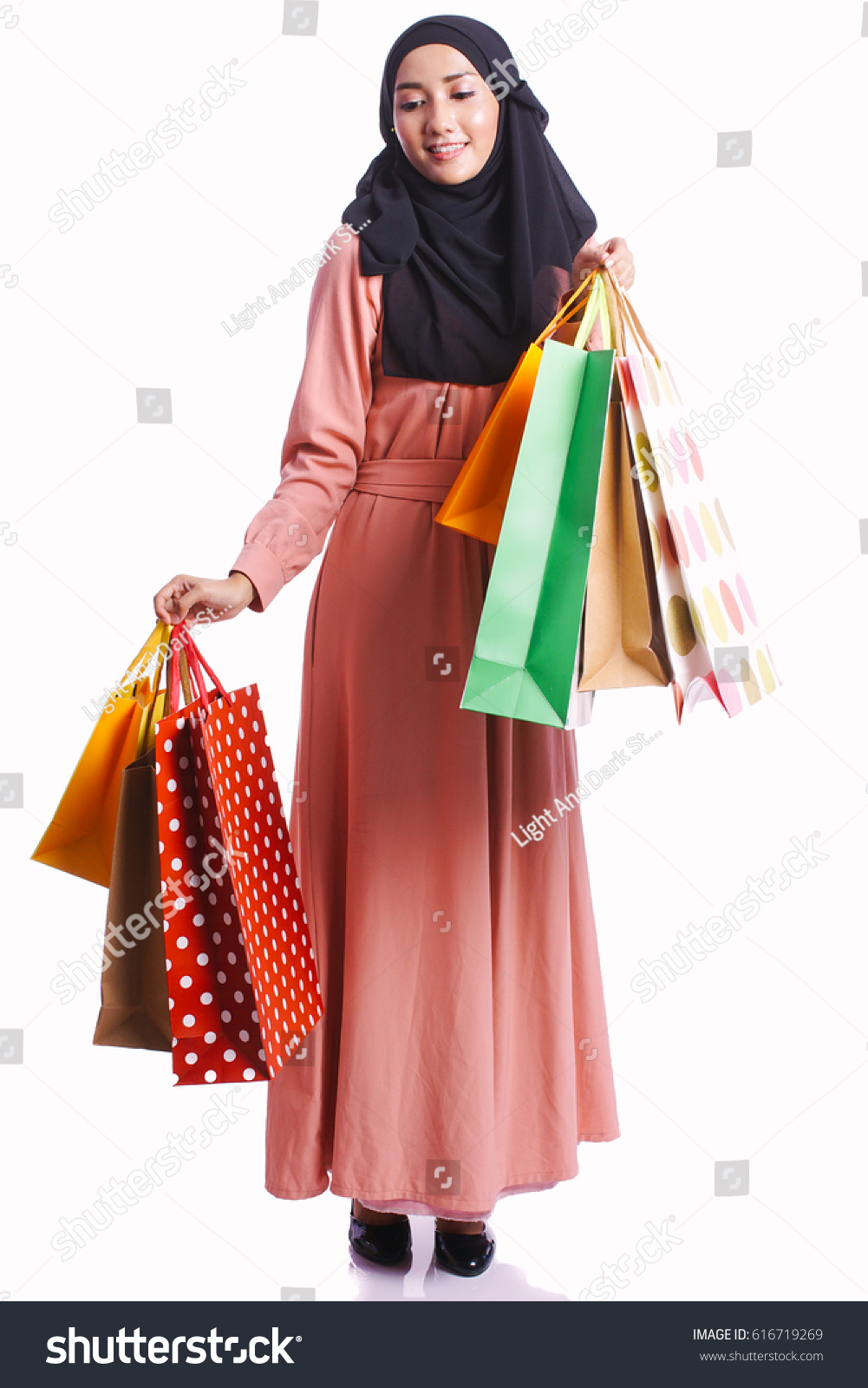 Woman posing with shopping bags isolated on white background full - Woman Wear Peach Dress Hold A Lot Of Shopping Bag Posing Isolated On White Background