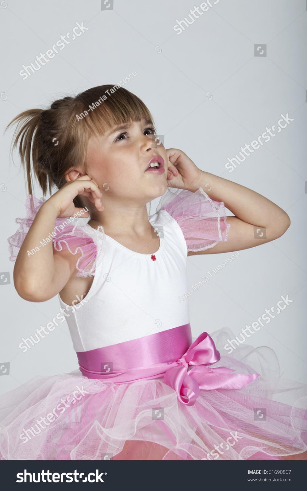 xusenet.com nonude Portrait of a cute little ballerina that is covering her ears,gesturing a  loud noise