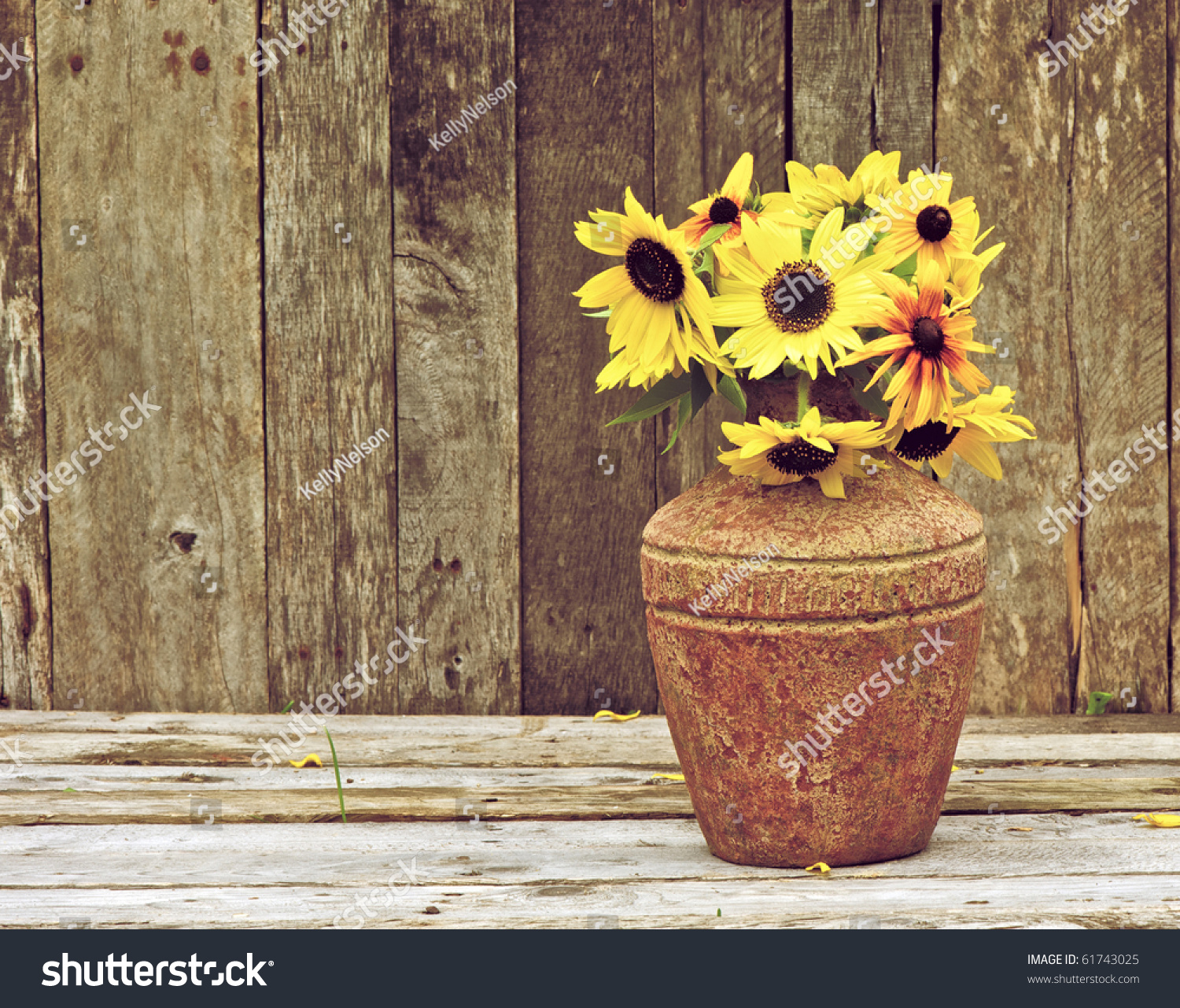 Sunflowers In A Vase On Rustic Grunge Background With Copy Space