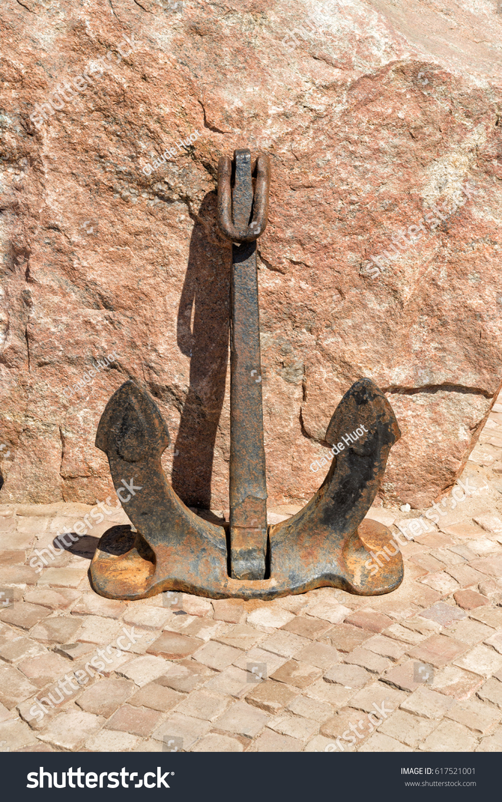 Stockless anchor in front of a boulder at the entrance of a restaurant in Swakopmund, Namibia.