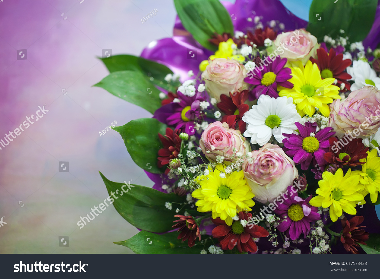 Beautiful aster flower bouquet on wooden stock photo 617573423 beautiful aster flower bouquet on wooden table izmirmasajfo