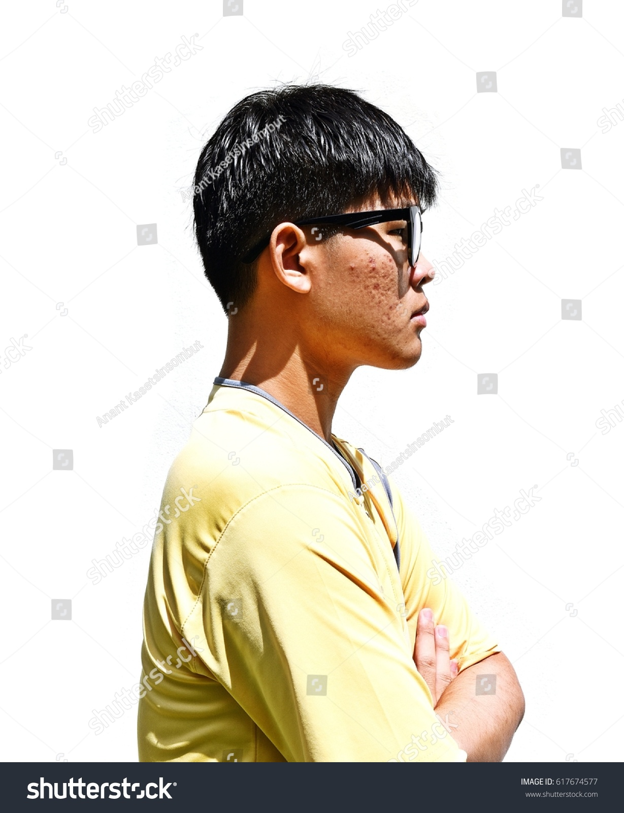 Side Portrait of Asian teenage men,A new generation in Asia,Teenagers wear  black frame glasses,Thai teen people wearing yellow shirt on white  background ...