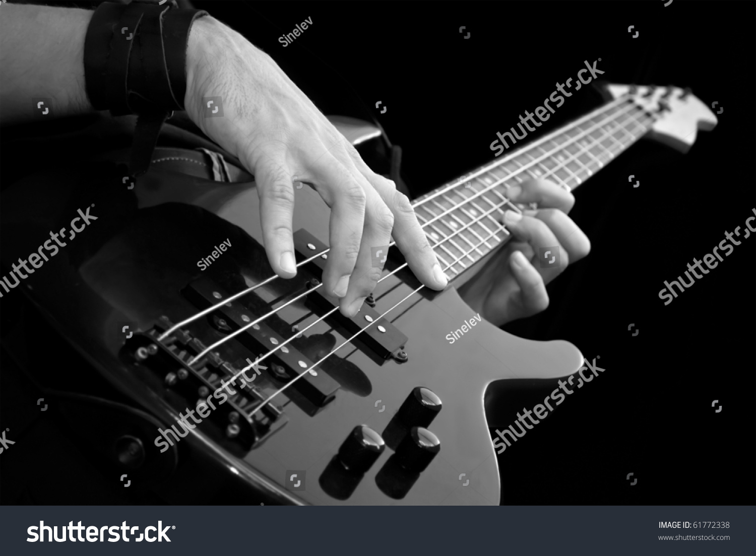 electrical bass guitar in male hands black and white stock photo 61772338 shutterstock. Black Bedroom Furniture Sets. Home Design Ideas