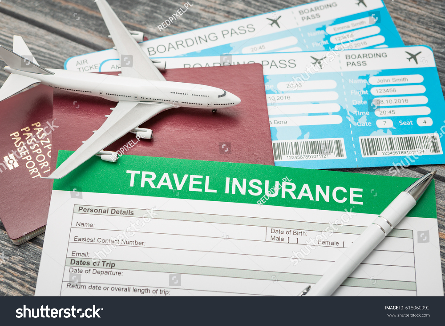 Insurance form located on desk passports stock photo royalty free the insurance form is located on a desk with passports and air tickets small plane thecheapjerseys Choice Image