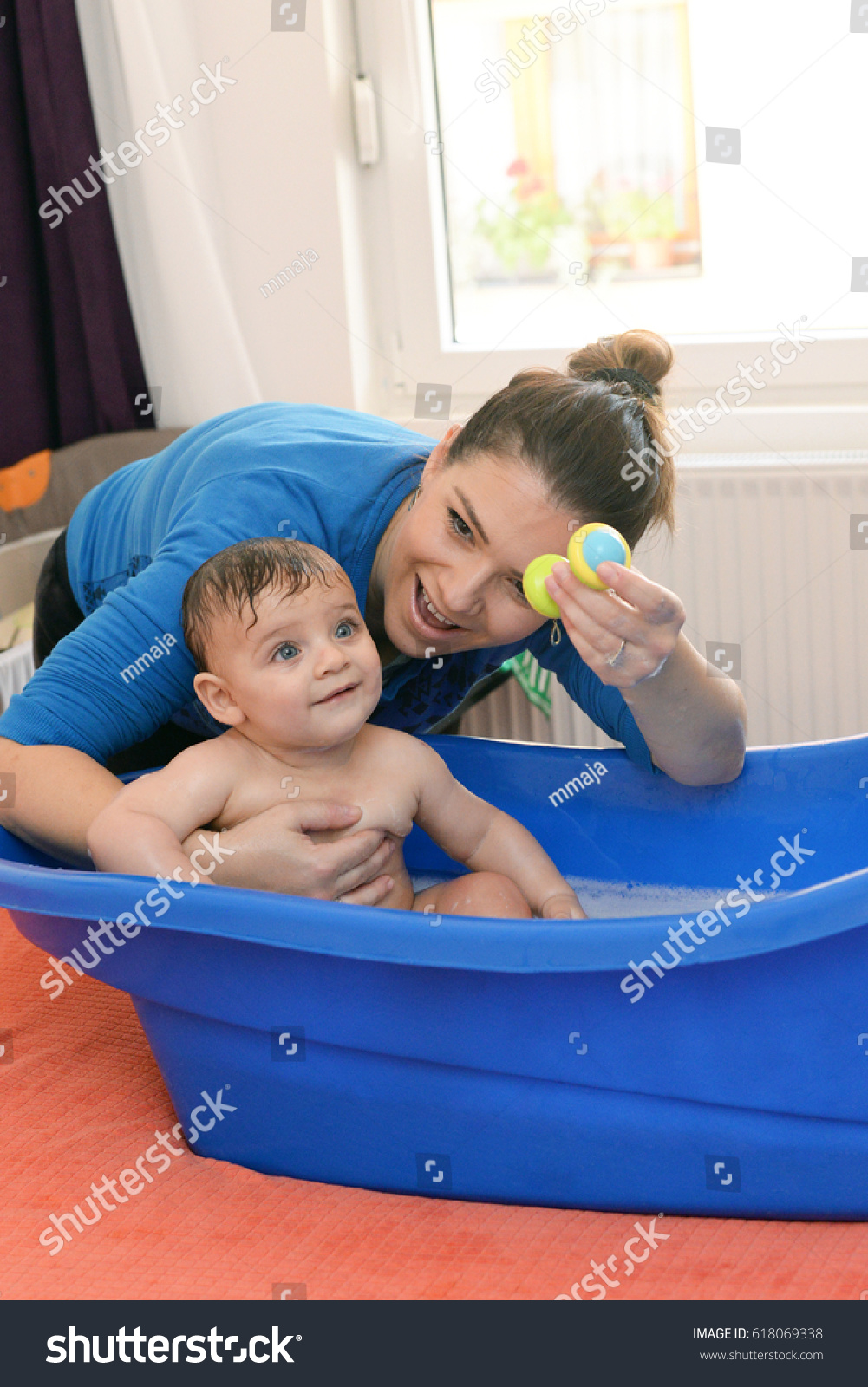 Mother Bathing His Happy Smiling Baby Stock Photo 618069338 ...