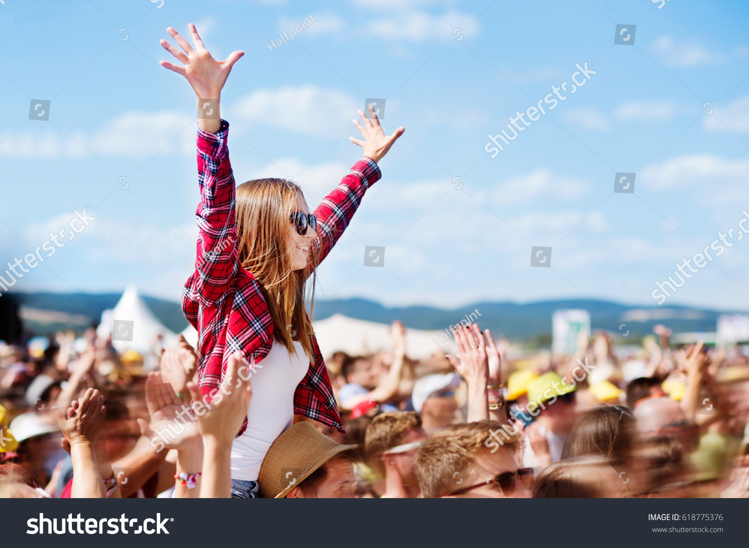Teenagers at summer music festival enjoying themselves #618775376