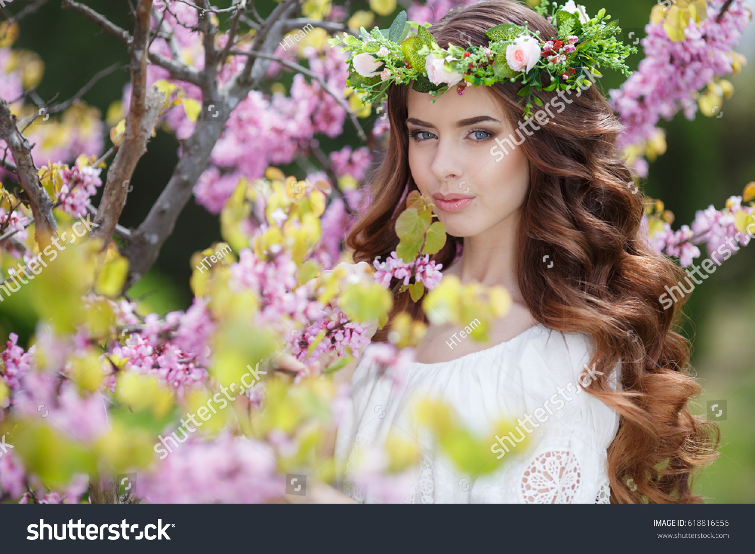 Spring woman flowers beautiful woman flower stock photo royalty spring woman in flowers beautiful woman with flower wreath portrait of young beautiful woman izmirmasajfo Image collections