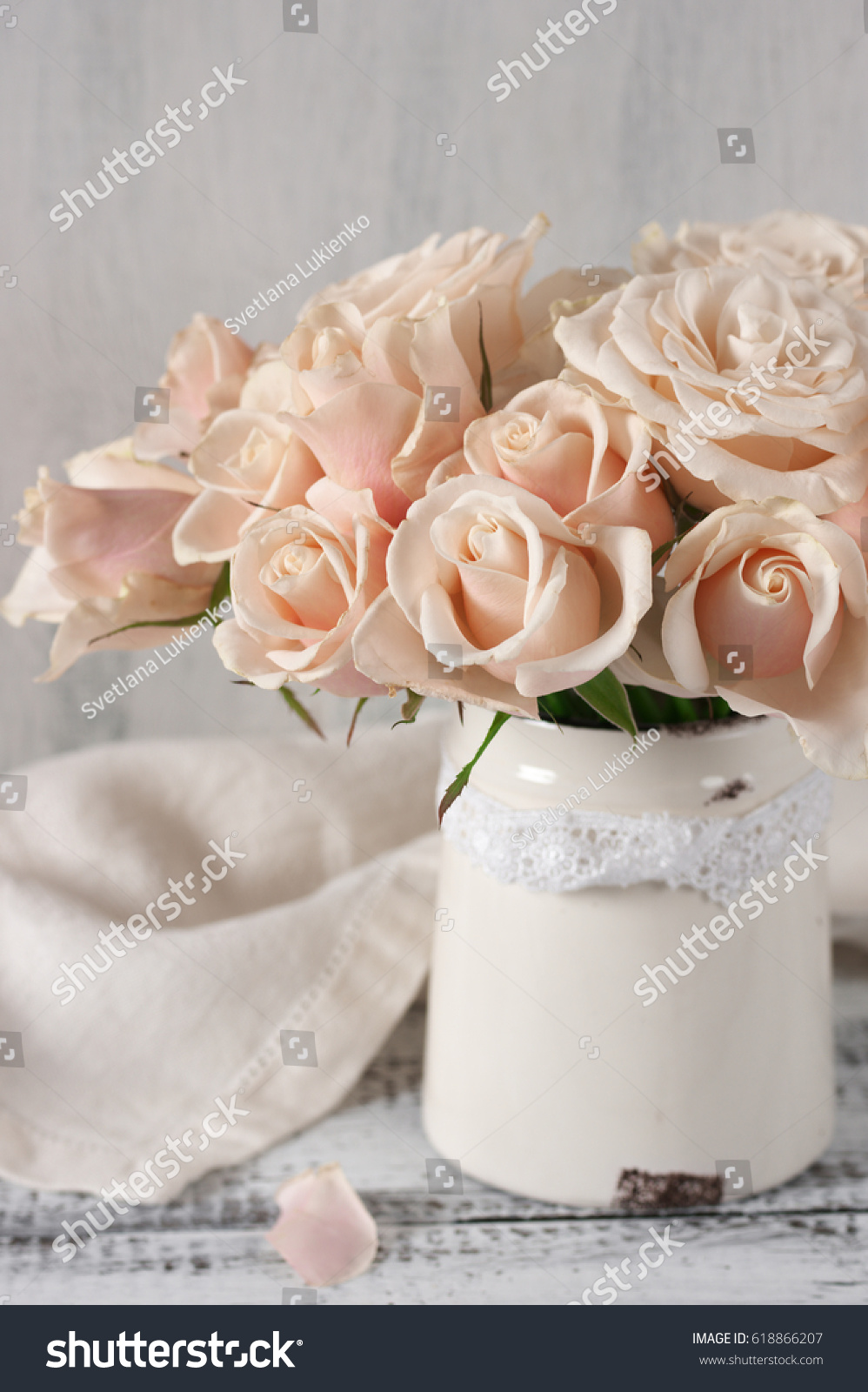 Bouquet of delicate pink roses in vintage tin vase on white rustic ...