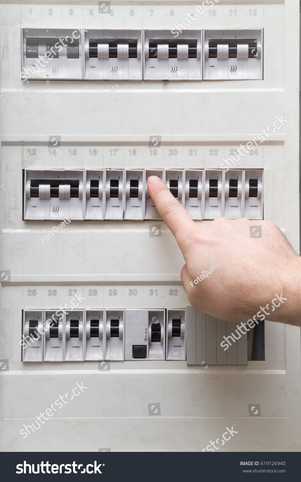 Mans Finger Checking Electricity Fuse Box Stock Photo Edit Now Rcd Circuit Breaker Together With Safety Switch Photos An In The Dangerous Activity Indoor